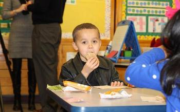 PHOTO: Allowing children to eat breakfast in the classroom is one way to boost participation in school meal programs, and also to ensure that kids don't start the day hungry. Courtesy of Food Research & Action Center.