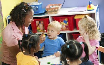PHOTO: Preschool classroom, with one teacher for four students. Courtesy: Qualistar Colorado.