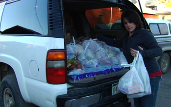 PHOTO: Colorado schoolteacher Leslie Nichols brings food to help her students in the film