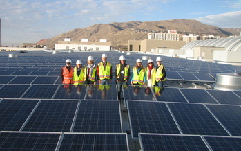 PHOTO: Utah Clean Energy staff and partners tour the Calvin L. Rampton Salt Palace Convention Center's solar installation. Courtesy of Utah Clean Energy.