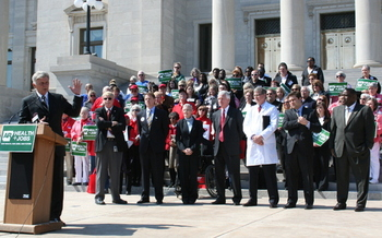 PHOTO: Gov. Mike Beebe shares his plan to cover more uninsured Arkansans with Thursday's crowd on the State Capitol steps. Photo by Anna Strong.