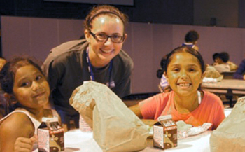 PHOTO: Federal sequestration is reducing the number of AmeriCorps VISTA members who help to feed hungry children meals during the summer months.  Photo courtesy of OAFB.<br />
