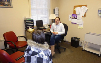 Agnes Misiaszek, SASS counselor, meets with a young girl served by the crisis intervention program    Courtesy of: LSSI