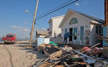 PHOTO: Homes in the Far Rockaways were damaged by storm surge from Hurricane Sandy. Six months later, counselors are still dealing with the effects on the emotional health of some Long Island children. Courtesy FEMA.