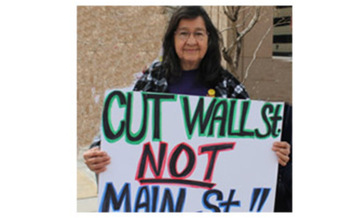 PHOTO: Sally Gallosa participated with other retirees and members of labor and environmental groups, protesting sequestration cuts in the public and private sector at a time when the New Mexico economy is weak. Courtesy: Miles Conway, Communications AFSCME Council 18.