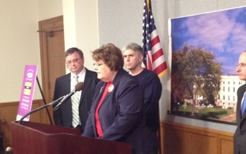 PHOTO: Peggy Hiestand-Harri and Rep. Joe Atkins at introduction of the bill to cut down on fraudulent wire transfers of money. Harri's mother was scammed out of $47,000. CREDIT: AARP MN