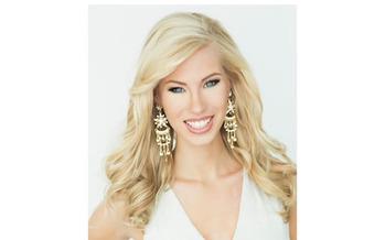 PHOTO: Miss Iowa, Nicole Kelly, is pushing a platform of