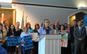 PHOTO: AARP New Hampshire volunteer Sherri Harden leads a press conference on Medicaid expansion. Photo Credit: Anne Saunders