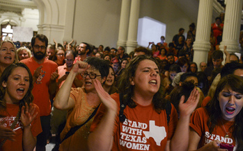 PHOTO: Opponents rallied at the State Capitol as abortion restrictions were turned back, only to be brought back to the forefront when Gov. Perry immediately called a second special session. Photo credit: Lauren Gerson.