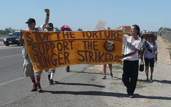 PHOTO: Supporters of the California prisoner hunger strike march outside Corcoran State Prison. Photo Credit: Urszula.