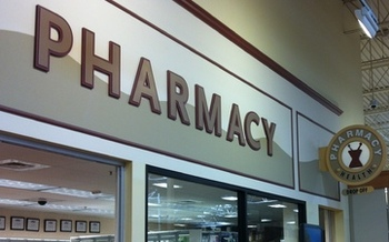 PHOTO: Some pharmacists in Ohio are thinking outside the pill box and using a whole-health approach to improve patient outcomes. Picture of a pharmacy sign. Credit: M. Kuhlman
