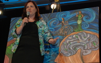 Photo: Holliday expresses her story and others through her art. Courtesy: Holliday