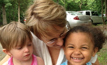 PHOTO: Cate Newbanks, executive director of the National Kinship Alliance for Children with children at camp for Kinship families. Supporters need 100,000 signatures at WhiteHouse.gov to make February