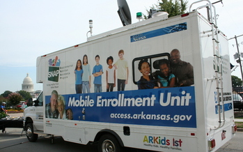 A cut in SNAP benefits this fall will reduce food subsides for Arkansas' low-wage families, according to the state's food banks. PHOTO of a mobile SNAP enrollment truck courtesy of Arkansas Advocates for Children & Families