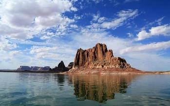 PHOTO: Gregory Butte, as seen from Lake Powell. The lake is as popular as a summer boating destination as it is a water source for the Southwest. Photo credit: Bob Moffitt, National Park Service.