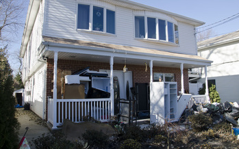 PHOTO: Nearly ten months since Superstorm Sandy barreled into New York, damaging houses like this oen in Oyster Bay, relief aid – from both private donors and government agencies – is slowly and carefully being doled out. Courtesy Howard Greenblatt/FEMA