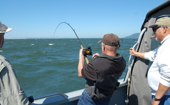 PHOTO: Some Northwest fishermen say the 'thrill of the catch' would be a lot less thrilling if coal shipments compromise air and water quality on the Columbia River. Photo credit: Nic Callero.