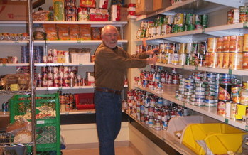 PHOTO: A volunteer stocks shelves at one of the Utah Food Bank's partner food pantries around the state. Courtesy Utah Food Bank.