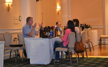 PHOTO: The Washington Dept. of Agriculture arranges trade meetings for local food and wine producers  with buyers from other countries. Here, Claar Cellars' Tom Mackenzie meets with buyers from Mexico. Courtesy Washington Dept. of Agriculture.