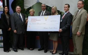 PHOTO: Michigan credit unions raised $100,000 in 2013 to support Children's Miracle Network hospitals throughout the state. Photo credit: Bryan Laviolette.