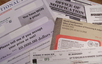 PHOTO: Some folks get a dozen or more of these mail-order prize solicitations every day – and older Oregonians are the most likely to open and answer them. Photo credit: Chris Thomas