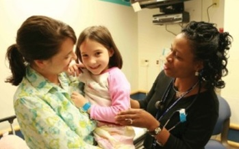 PHOTO:An Ohio facility is paving the way in finding the right balance between medical and psychiatric care to help treat young children. Photo: child with mom and doctor. Courtesy of Cincinnati Children's.