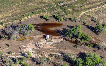 PHOTO: Crude oil leaking after flood near the South Platte River along the Front Range of Colorado in September 2013. Photo courtesy of EcoFlight, ecoflight.org.