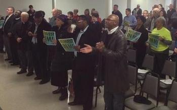 PHOTO: More than 200 people attended the ReInvest Express tour stop in Grand Rapids, where faith and civic leaders called on Gov. Snyder to put the needs of Michigan families and cities first. Photo courtesy Harriet Tubman Center.