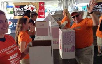 Photo: Volunteers help at Drive to End Hunger Event. Courtesy: Drive to End Hunger
