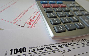 PHOTO: Volunteers with the AARP Foundation Tax Aide program will help Illinoisans file their simple tax returns for free. Photo courtesy of AARP.