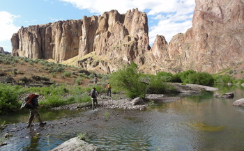 PHOTO: ONDA staff and volunteers survey a section of the Oregon Desert Trail in 2011, along the West Little Owyhee River in the Owyhee Canyonlands. Photo credit: Jeremy Fox.