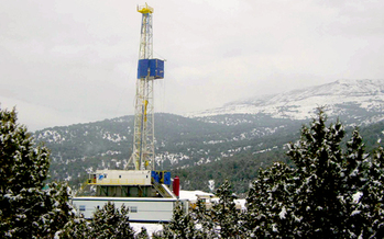 PHOTO: Natural gas rigs like this one near Rifle, CO would be subject to new rules about when and where they can operate, under a proposed ballot initiative. Credit: Wikimedia Commons.