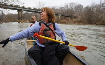 PHOTO: Jenny Edwards of the Dan River Basin Association meets with the Waterkeeper Alliance after a morning paddle past the coal-ash spill. Photo courtesy Waterkeeper Alliance