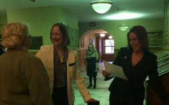 PHOTO: Glenna DeJong and Marsha Caspar of Lansing (left) were the first same-sex couple married in Michigan in a ceremony performed by Ingham County Clerk Barb Byrum, but they must now wait to know the fate of their marriage. Photo courtesy of Barb Byrum