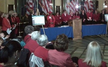 PHOTO: Supporters of equal pay legislation will again gather in the Capitol rotunda today, many wearing red to symbolize that women's paychecks are