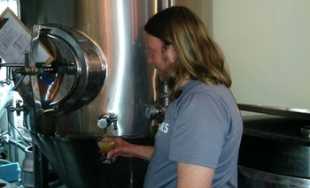 PHOTO: Brewer Kevin Klein tests the wares during the beer-making process. Since water is beer's chief ingredient, water quality is a critical factor. Photo courtesy NW Peaks Brewery.