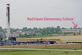 PHOTO: This photo, seen in the petition filed by Earthjustice on Tuesday, shows an Erie, Colo., school located within two miles of 66 oil and gas well sites. Photo courtesy Lighthouse Solar.